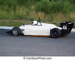 Racing car on the track - White racing car during the race...