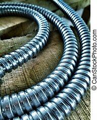 Silver Electrical Wire - Silver electrical wire on wood...