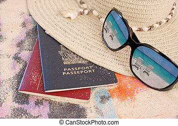 tropical beach travel - travel passports on beach towel and...
