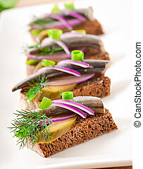 Sandwiches with herring - Sandwiches of rye bread with...