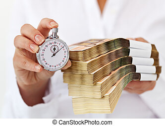 Limited time offer concept with stack of money and stopwatch...