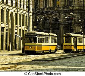 Milan old city - Old orange tram in Milan, Italy