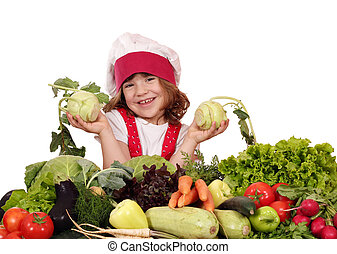 beautiful happy little girl cook with vegetables
