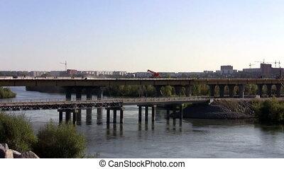 Crane on a bridge over a river