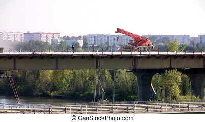 Crane on a bridge a hot day