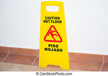the sign wet floor caution is about a wall