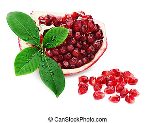 Part of pomegranate fruit with green leaves isolated on...