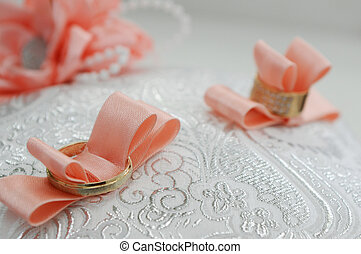 two wedding rings lie on a tray