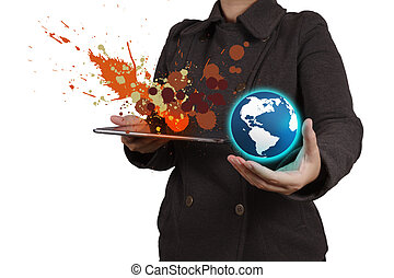 businesswoman working with tablet computer showing the earth and splash colors as creative concept