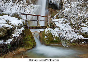 Bridge with Waterfall in Winter - Waterfall with icicles and...