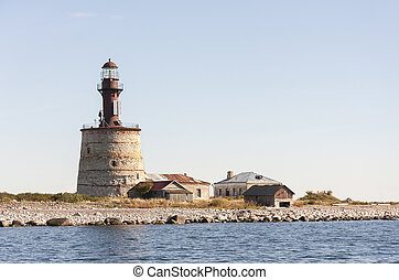 Ancient lighthouse on an island - Ancient stone made...