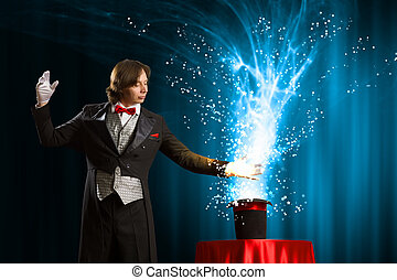 Magician with hat - Image of magician holding hat with...