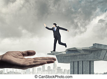 Risky business - Image of running businessman at the edge of...