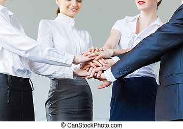Business team - Business people making pile of hands....