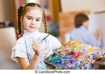 Cute girl painting - Little cute girl with paint brush and...