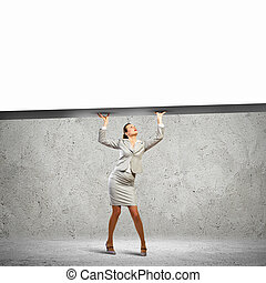 Businesswoman with banner - Businesswoman holding blank...