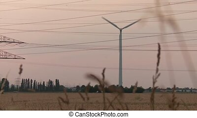 Wind Engine and Acre with Sunset - video footage of a wind...