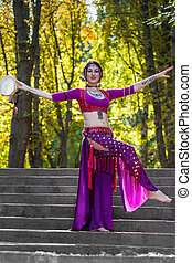 Oriental Dancer on stairs in the park