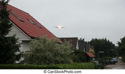 Deep flying Aircraft over Houses - video footage of deep...