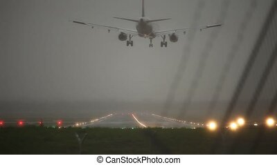 Landing Aircraft - video footage of a stormy landing...