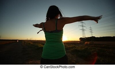 Woman turns around in sunset - video footage of a happy...