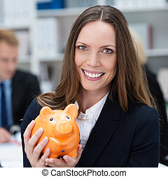 Business woman with a piggy bank - Attractive smiling...