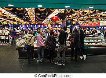 People in the mall - HONG KONG - FEBRUARY 22: Many people in...