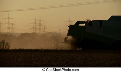 Combine harvester on grainfield - video footage of a combine...