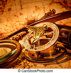 Vintage items on ancient map. - Vintage compass, goose quill...