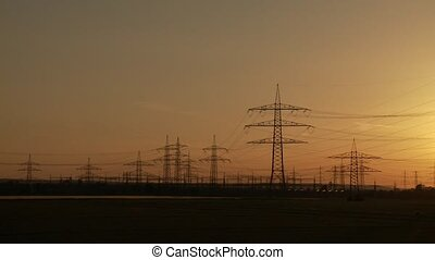 Sunset with Power Poles - video footage of a landscpape with...