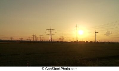Sunset with electrical power supply - video footage of a...