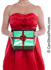 Woman holding gift wrapped present.