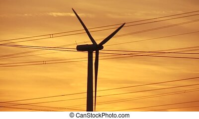 Green Energy, Sunset - video footage of a wind engine in...