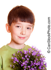 boy with spring flowers in flowerpot isolated on white