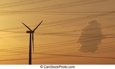 Wind Engine in Sunset - video footage of a wind engine in...