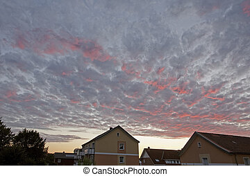 Evening sky with dark and red clouds in Lower Saxony -...