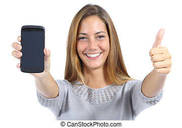 Beautiful woman showing a smartphone with thumb up isolated...