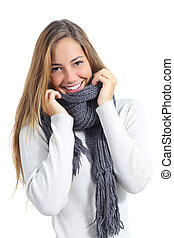 Happy beautiful woman keeping warm in a sweater in a cold...