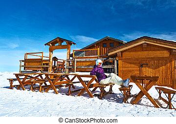 Mountain ski resort - Woman at winter ski resort,...