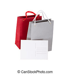 papers bag with a gift card - bags with tag closeup on white...
