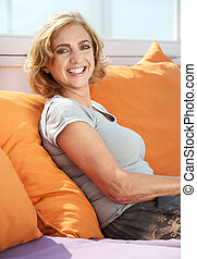 Middle aged woman smiling outdoors - Closeup portrait of a...