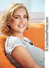 Portrait of a beautiful woman relaxing outdoors - Closeup...