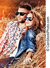 countryside - Beautiful young couple in casual clothes...