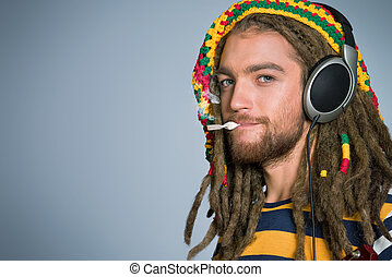 different - Portrait of a happy rastafarian young man...