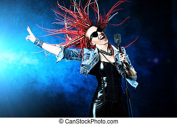 dynamic song - Modern rock singer singing into a microphone.