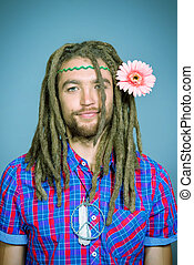 free style - Portrait of a hippie young man with a flower.