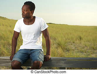 Attractive young man relaxing outdoors