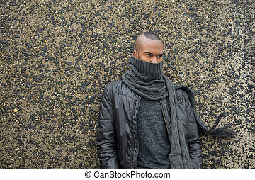 Male fashion model with scarf and leather jacket