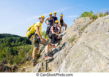 Group Of Climbers On Rock - Group of climbers with safety...