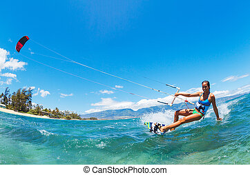 Kiteboarding - Attractive Young Woman KiteBoarding, Fun in...